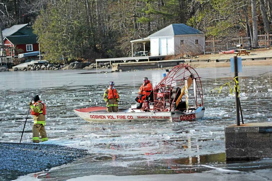 KAITLIN MCCALLUM — THE REGISTER CITIZEN  An airboat from Goshen fire department breaks up ice on West Hill Pond so a state police boat could search the area for a missing kayaker. Photo: Journal Register Co.