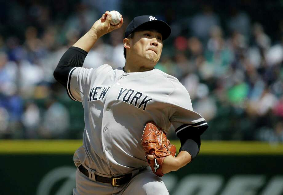 New York Yankees starting pitcher Masahiro Tanaka throws against the Seattle Mariners in a baseball game, Wednesday, June 3, 2015, in Seattle. (AP Photo/Ted S. Warren) Photo: The Associated Press   / AP