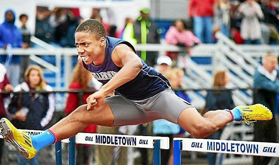 Shawn Fletcher, of Hillhouse won the 110 hurdles with a time of 14.79 in the CIAC Class MM Track & Field Championships Tuesday at Middletown High School. Hillhouse won the meet, edging East Lyme. Photo: Catherine Avalone--New Haven Register
