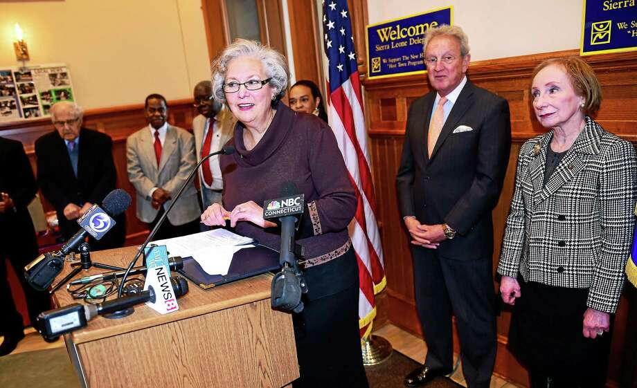 Althea Norcott (center), Chairman of the Freetown Sister City Committee, speaks at a press conference at City Hall in New Haven on 3/2/2015 announcing the donation of vans to be outfitted as ambulances destined for New Haven's sister city, Freetown, in Sierra Leone. Photo: Arnold Gold-New Haven Register)
