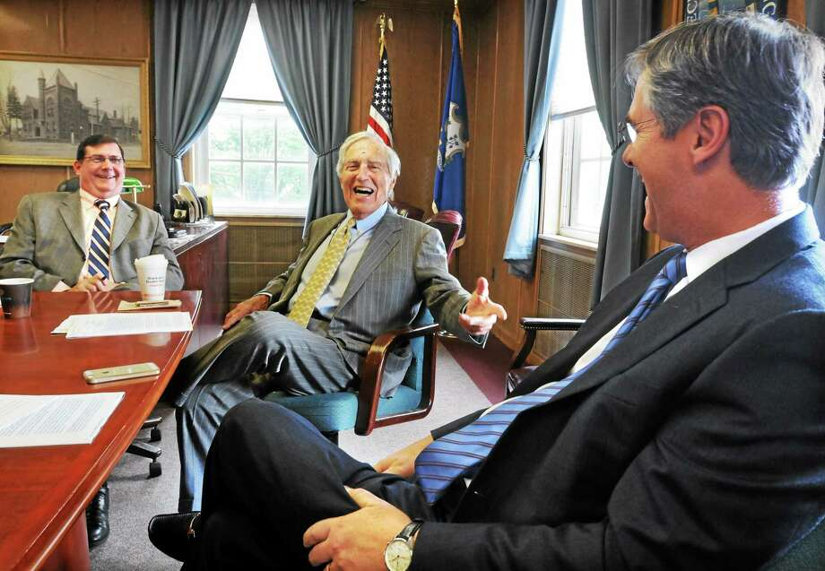 MARA LAVITT — NEW HAVEN REGISTER FILE PHOTO  Developer Sheldon Gordon of Greenwich and real estate investor Ty Miller of Dallas announced a proposed a high-end outlet center for West Haven near the Kimberley Avenue/Officer Robert Fumiatti Bridge. From left: West Haven Mayor Edward O'Brien, Gordon and Miller in this June 2014 photo. Photo: Journal Register Co. / Mara Lavitt