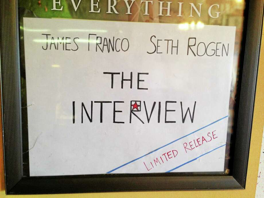 "A handmade sign advertises ""The Interview"" at Cine-4 in New Haven. Photo: Journal Register Co."