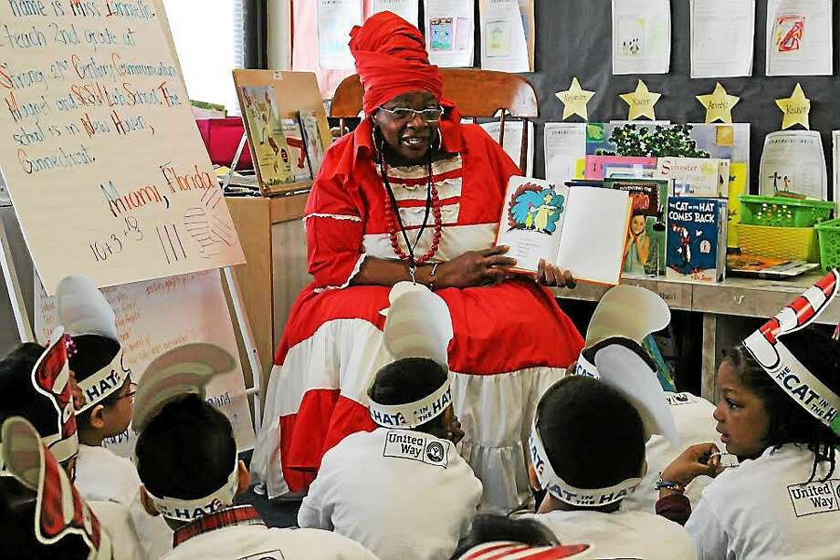 Yale-New Haven Hospital volunteer Janice Hart reads to students Monday. Photo: Contributed Photo