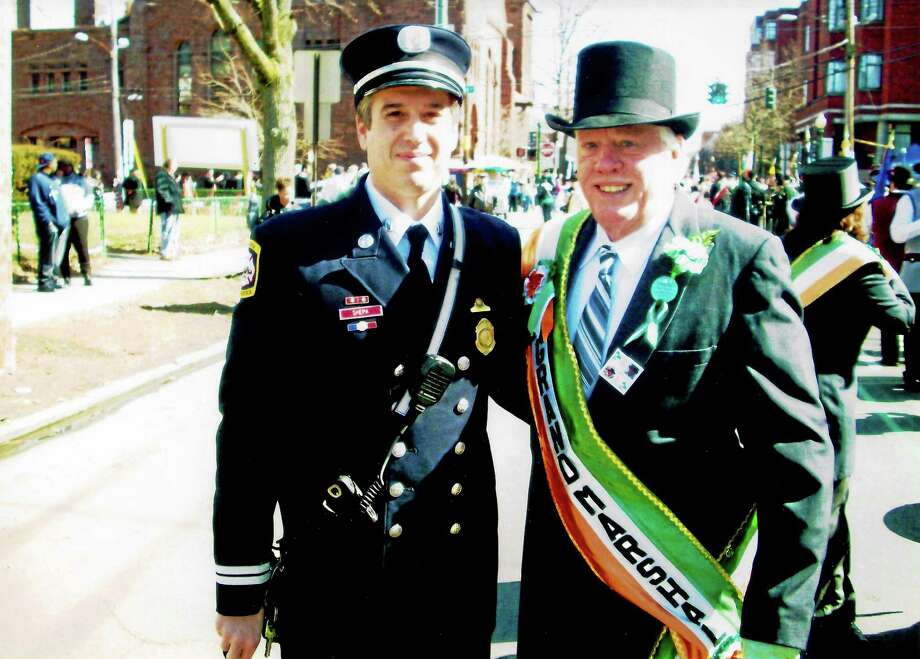 John R. O'Connor, grand marshal of the 1988 Greater New Haven St. Patrick's Day Parade, is photographed on the parade route with his nephew, New Haven Fire Department Battalion Chief John Shepa. O'Connor will receive West Haven's Irishman of the Year honor at noon March 17 on the Campbell Avenue side of City Hall. Photo: (Contributed Photo)