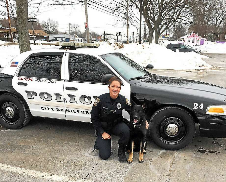 Milford police Officer Emily Covelli and K9 Zeus. Photo: Photo Courtesy Of The Milford Police Department