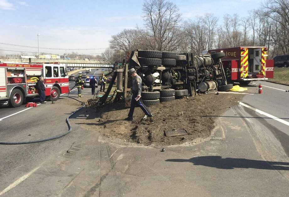 Fire and police officials work at the scene of a fatal truck crash Thursday in Fairfield. Photo: Associated Press — Fairfield Fire Department   / Fairfield Fire Department