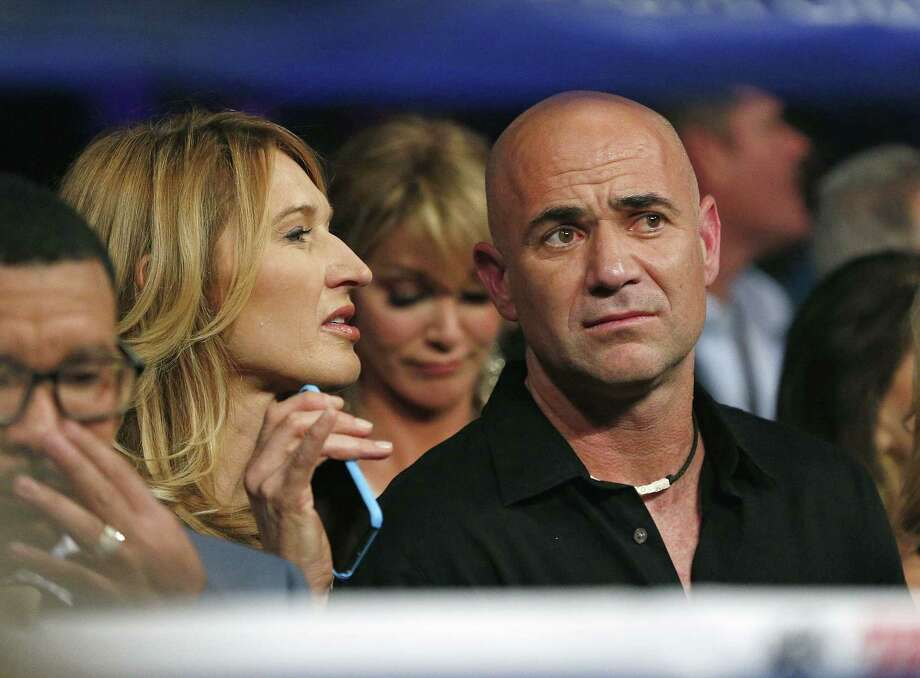 Steffi Graf, left, and Andre Agassi join the crowd before the start of the fight between Floyd Mayweather Jr. and Manny Pacquiao on Saturday in Las Vegas. Photo: John Locher — The Associated Press   / AP
