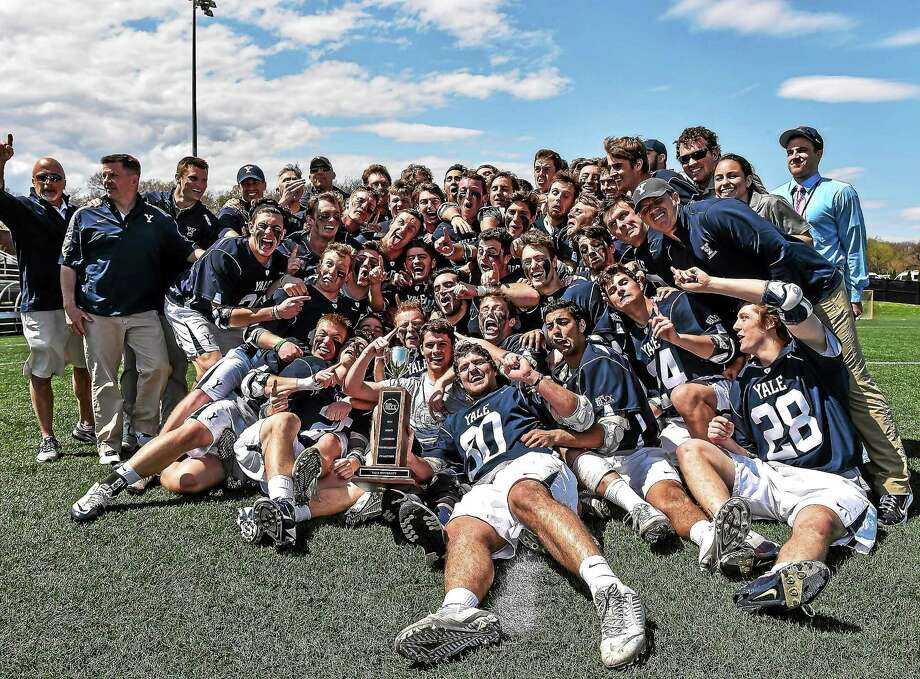 Members of the Yale men's lacrosse team celebrate after winning the Ivy League championship on Sunday. Photo: The Ivy League/Sideline Photos   / WGD Action Photography