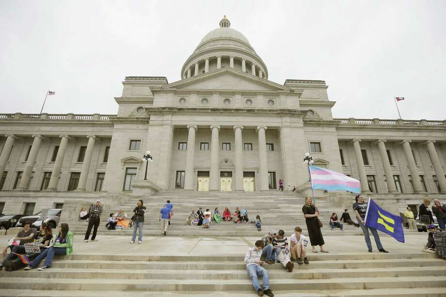 Opponents of a religious freedom bill gather at the Arkansas state Capitol in Little Rock, Ark., Thursday, April 2, 2015. The measure later passed in the Arkansas House and was signed into law. Photo: (AP Photo/Danny Johnston) / AP