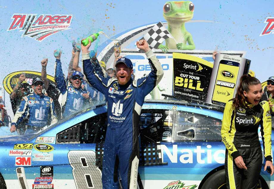 Dale Earnhardt Jr. celebrates in Victory Lane after winning the Talladega 500 on Sunday. Photo: David Tulis — The Associated Press   / FR170493 AP