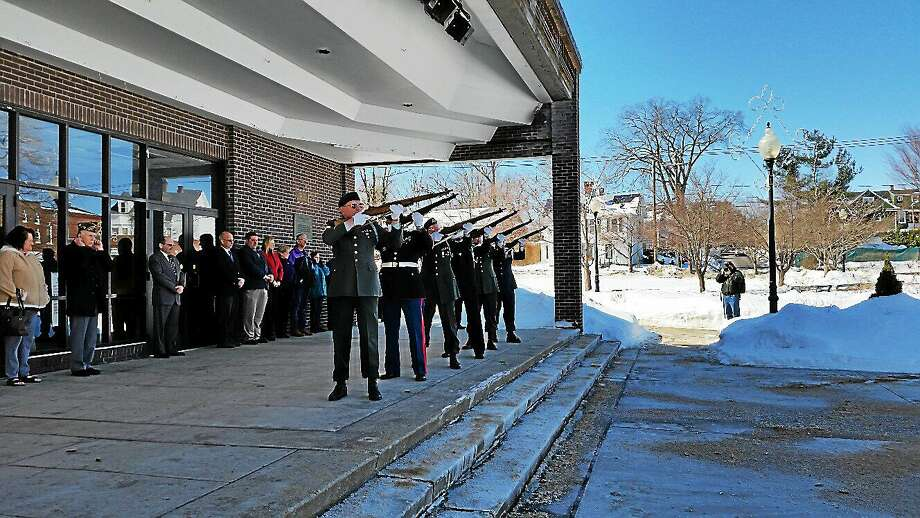 A gun salute honors veterans during a Gulf War Veterans Day observance ceremony at Torrington's Coe Memorial Park Center on Saturday afternoon. The event was sponsored by the Torrington Veterans Support Committee. Photo: Journal Register Co.