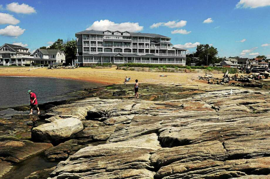Following the approval of a controversial new zoning district, neighbors near the Madison Beach Hotel have filed an appeal of the Planning and Zoning Commission's decision to approve the creation of the West Wharf District. Photo taken 2013 before the house next door owned by the hotel was rebuilt as well as the structure on the Fish House property. Photo: Peter Hvizdak — NEW HAVEN Register   / ©Peter Hvizdak /  New Haven Register