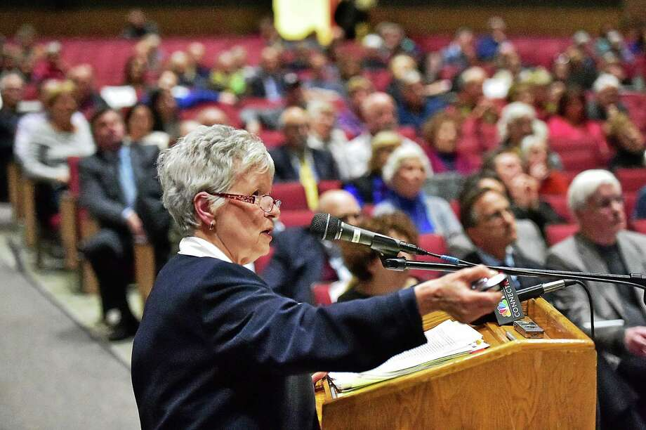 "Branford resident Kate Galambos speaks in opposition of the proposed Costco development at the Branford Planning and Zoning Commission's public hearing Thursday. ""The traffic backup will be in all directions, every Interstate 95 trip to the shopping center will be using our town roads,"" she said. Photo: Catherine Avalone — New Haven Register    / New Haven RegisterThe Middletown Press"