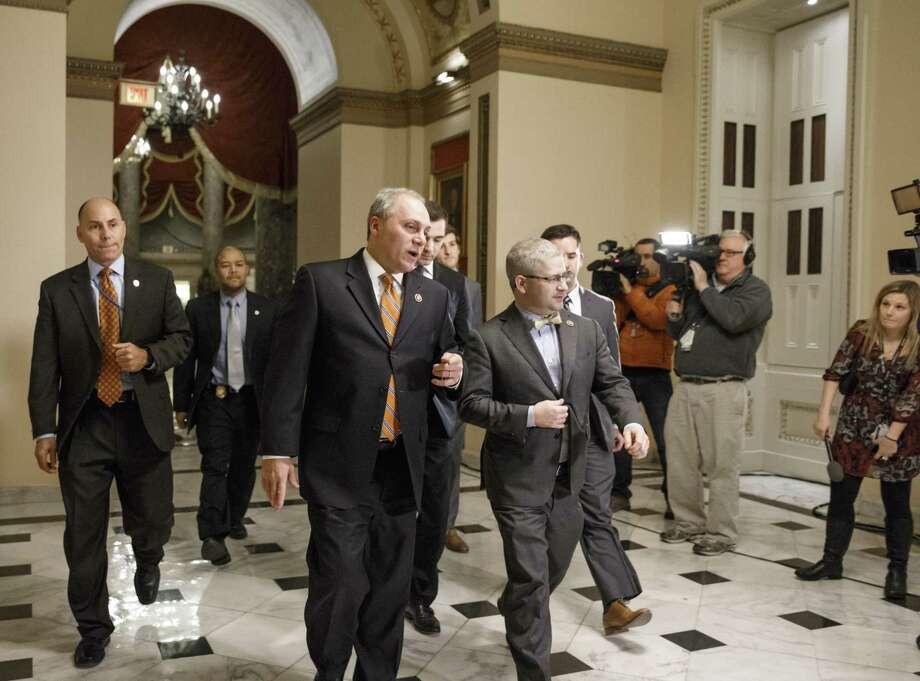 House Majority Whip Steve Scalise, R-La., center left, and  Rep. Patrick T. McHenry, R-N.C., the chief deputy whip, walk to the chamber as Congress passed a one-week bill late Friday night, Feb. 27, 2015, to avert a partial shutdown of the Homeland Security Department, as leaders in both political parties quelled a revolt by House conservatives furious that the measure left President Barack Obama's immigration policy intact, at the Capitol in Washington. Photo: AP Photo/J. Scott Applewhite   / AP