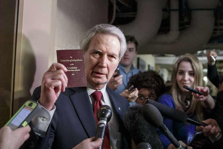 Rep. Walter B. Jones, R-N.C., holds up a copy of the Constitution while talking to reporters as House Republicans emerge from a closed-door meeting on how to deal with the impasse over the Homeland Security budget at the Capitol in Washington last week. Photo: AP Photo   / AP
