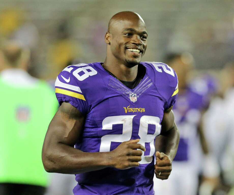 In this Aug. 8, 2014 photo, Minnesota Vikings running back Adrian Peterson leaves the field after an NFL preseason football game against the Oakland Raiders in Minneapolis. Photo: AP Photo/Jim Mone, File   / AP