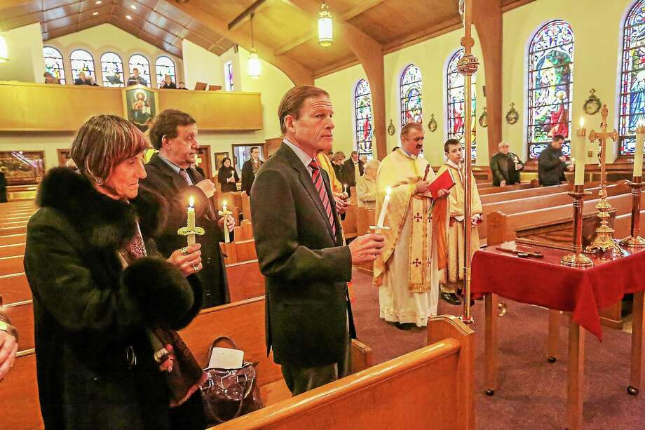 U.S. Rep. Rosa DeLauro and Sen. Richard Blumenthal attend the Memorial service at St Michael's Ukrainian Church in New Haven Sunday. The Service commemorates the 1st anniversary of the killing of 100 Ukrainians at Independence Square in Kiev. Photo: John Vanacore Photo   / John Vanacore