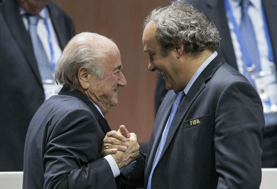 FIFA president Sepp Blatter, left, says he will resign. Photo: Patrick B. Kraemer — The Associated Press   / KEYSTONE