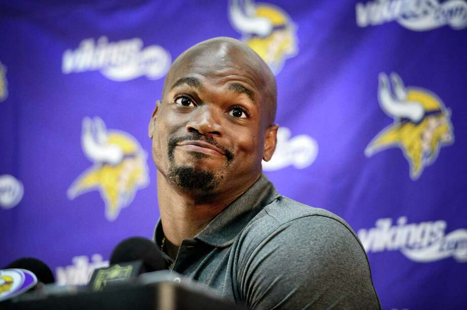 Vikings running back Adrian Peterson speaks at a news conference Tuesday in Eden Prairie, Minn. Photo: Glen Stubbe — Star Tribune   / Star Tribune
