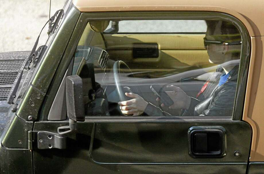 A driver uses an iPhone. Photo: AP Photo/Damian Dovarganes, File   / AP