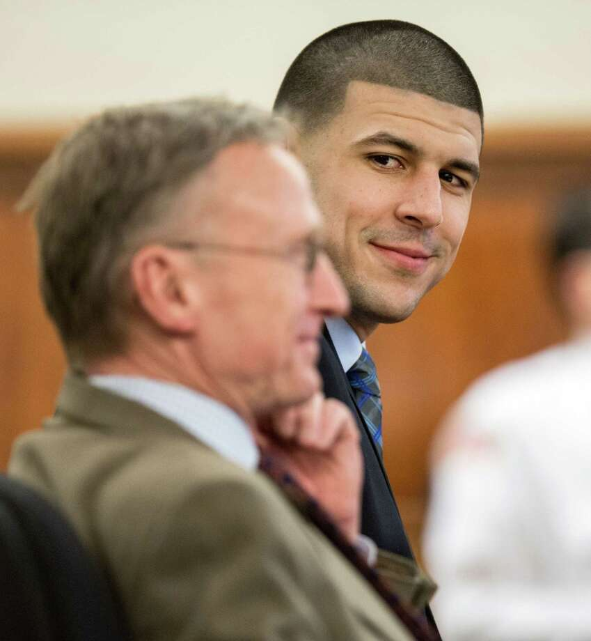 Former New England Patriots football player Aaron Hernandez, right, smiles at his attorney Charles Rankin during his murder trial, Tuesday, March 31, 2015, at Bristol County Superior Court in Fall River, Mass. Hernandez is accused of killing Odin Lloyd in June 2013.  (AP Photo/The Boston Globe, Aram Boghosian, Pool) Photo: AP / Pool The Boston Globe