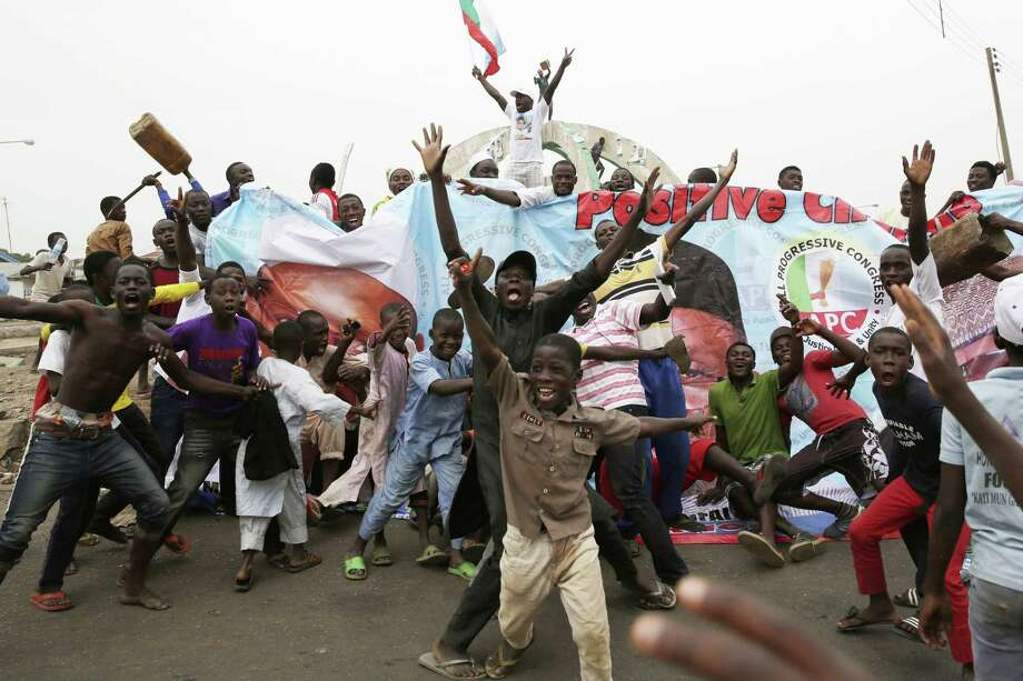 Residents celebrate the anticipated victory of Presidential candidate Muhammadu Buhari  in Kaduna,  Nigeria Tuesday, March 31, 2015. The spokesman for retired Gen. Muhammadu Buhari says the former military dictator has won Nigeriaís bitterly contested presidential election but fears ìtricksî from the government. Garba Shehu told The Associated Press that their polling agents across the country tell them they have succeeded in defeating President Goodluck Jonathan.(AP Photo/Jerome Delay) Photo: AP / AP