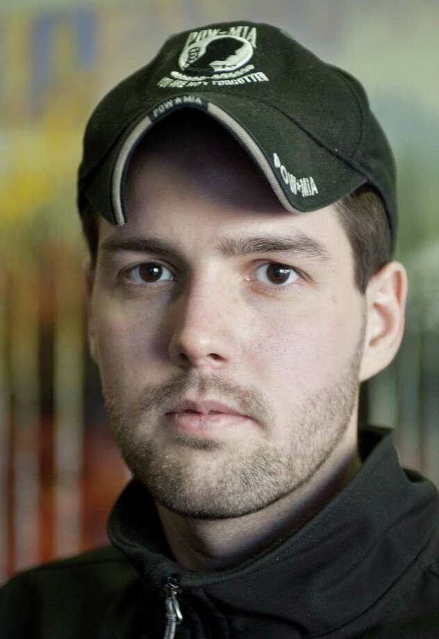 This Feb. 2011 photo shows decorated Iraq War veteran Roy Murry. Murry's estranged wife, Amanda, told authorities her husband suffered from post-traumatic stress and was becoming increasingly delusional, according to court documents released Monday, June 1, 2015. Murry remained in custody after surrendering to authorities on Saturday, four days after the home of his wife's family was set on fire near Colbert, Spokane County Sheriff Ozzie Knezovich said. (Colin Mulvany/The Spokesman-Review, via AP) Photo: AP / THE SPOKESMAN-REVIEW