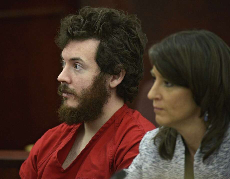 FILE - In this March 12, 2013, file photo, James Holmes, left, and defense attorney Tamara Brady appear in district court in Centennial, Colo., for his arraignment. Prosecutors are methodically building a case that Holmes knew right from wrong when he planned and carried out the deadly Colorado theater shooting, hoping to convince jurors that he should be convicted and executed and not sent to a mental hospital. (RJ Sangosti/The Denver Post via AP, Pool, File) Photo: AP / Pool Denver Post