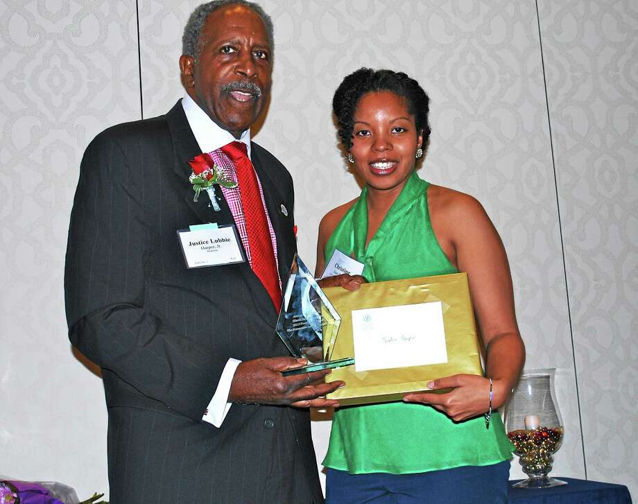(Contributed photo) Christine Jean-Louis, assistant attorney general in the Office of the Attorney General, presents Justice Lubbie Harper Jr. with the George W. Crawford Black Bar Association's Trailblazer Award Photo: Journal Register Co.