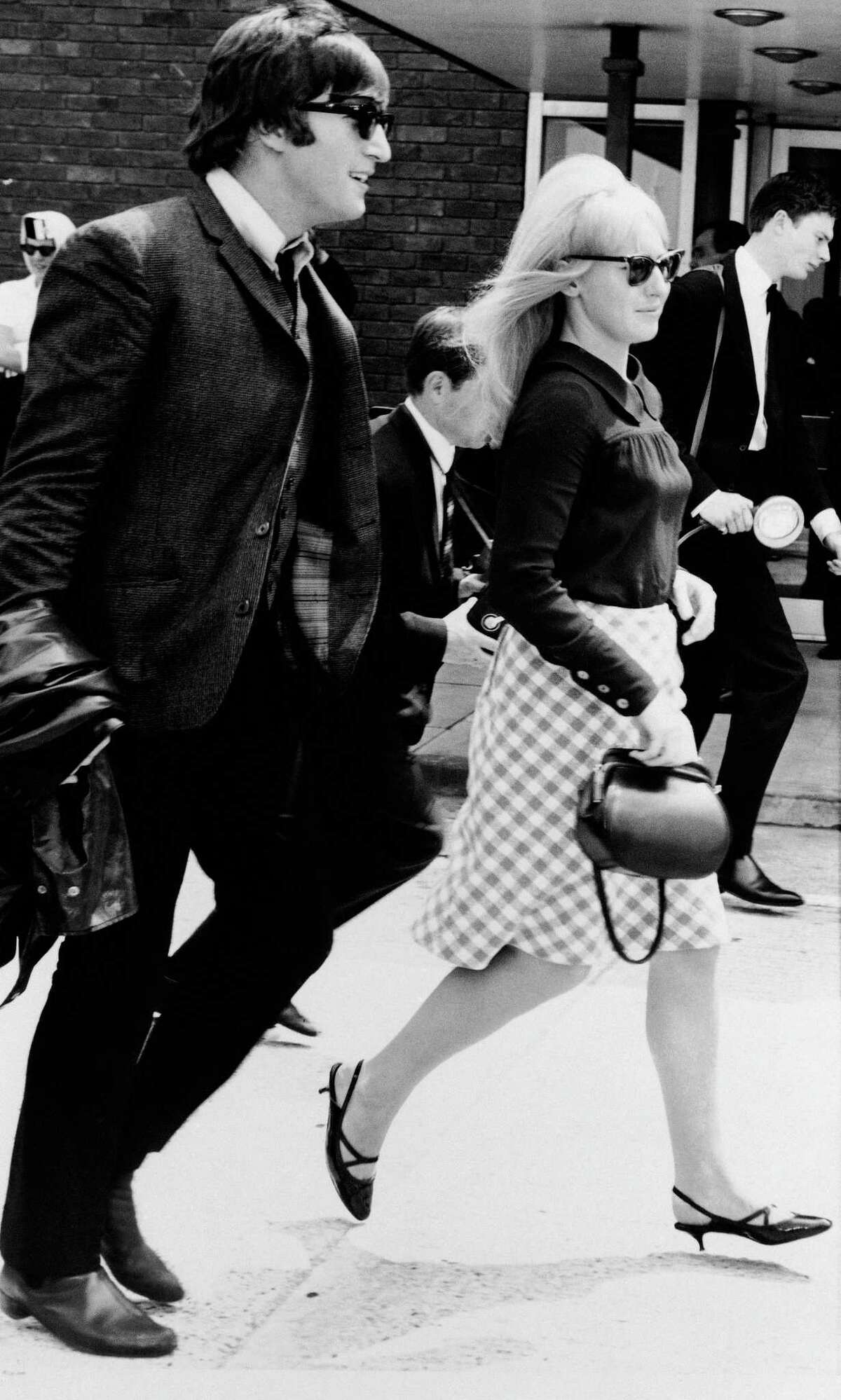 File- In this July 2,1964 file photo, singer John Lennon and his then wife, Cynthia, at Luton airport after 'The Beatles' arrived home from their three-week tour of Australia and New Zealand. Cynthia Lennon passed away on Thursday, April 1, 2015, aged 75, at her home in Mallorca, Spain, following a short but brave battle with cancer. (AP Photo/Victor Boynton, File)