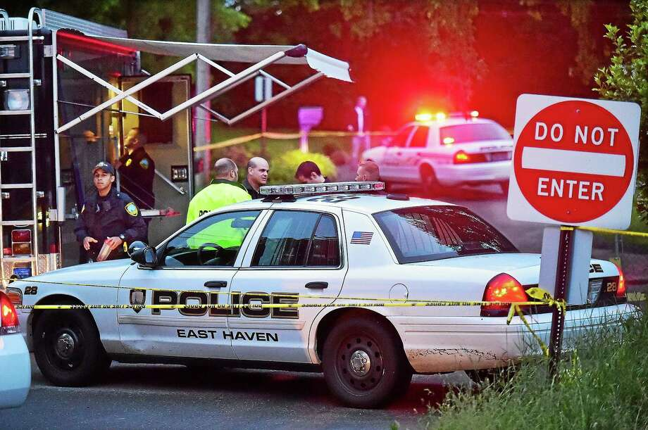 Members of the Connecticut State Police Major Crime Squad and East Haven Police Department at the scene of an East Haven home at 541 Strong St. where two young children were found dead Tuesday. Photo: Catherine Avalone — New Haven Register     / New Haven RegisterThe Middletown Press
