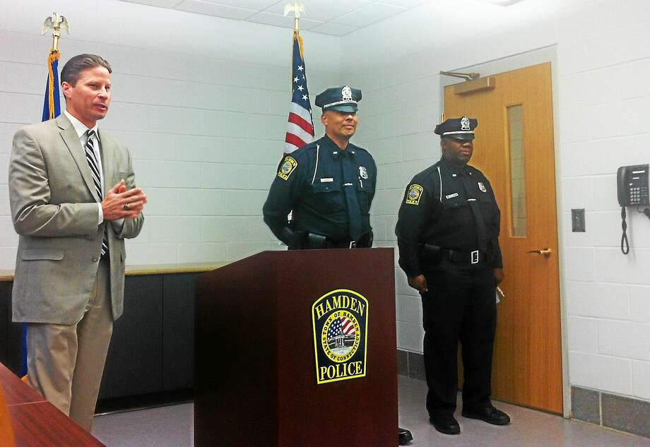 From left, Police Chief Thomas Wydra welcomes new officers Luis Rivera and Lloyd Barrett to the Hamden Police Department before they were officially sworn in Tuesday. Photo: Kate Ramunni — New Haven Register