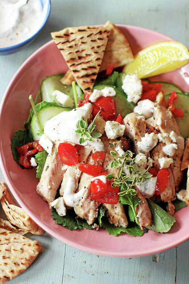 Try Grilled Greek Chicken Pita as a salad. Photo: Matthew Mead — Associated Press   / FR170582 AP