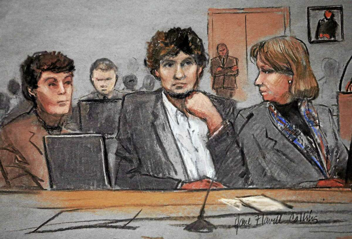 In this courtroom sketch, Dzhokhar Tsarnaev, center, is depicted between defense attorneys Miriam Conrad, left, and Judy Clarke, right, during his federal death penalty trial, Thursday in Boston. Tsarnaev is charged with conspiring with his brother to place two bombs near the Boston Marathon finish line in April 2013, killing three and injuring 260 people.