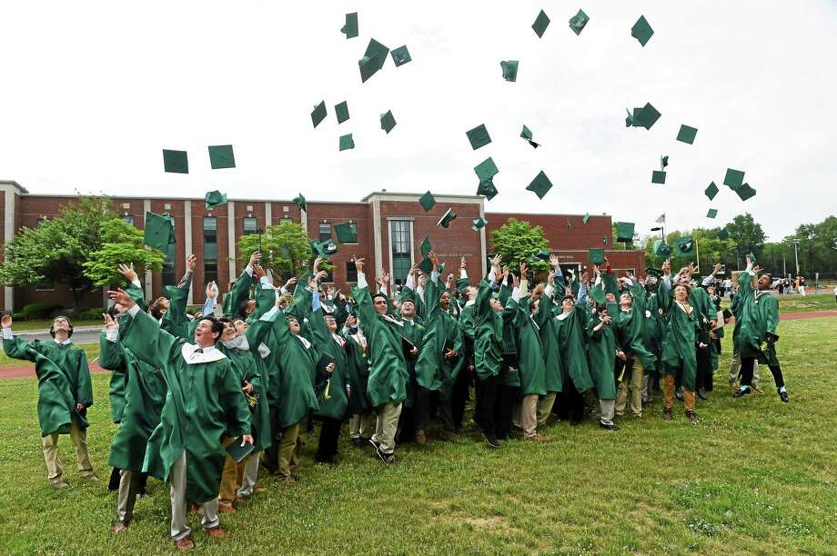 The 2015 graduating class at Notre Dame High School of West Haven celebrate by tossing  their mortar boards into the air after Notre Dame High School's 66th Annual Commencement Exercises in West Haven on Sunday, May 31, 2015. Photo: Peter Hvizdak--New Haven Register   / ©2015 Peter Hvizdak