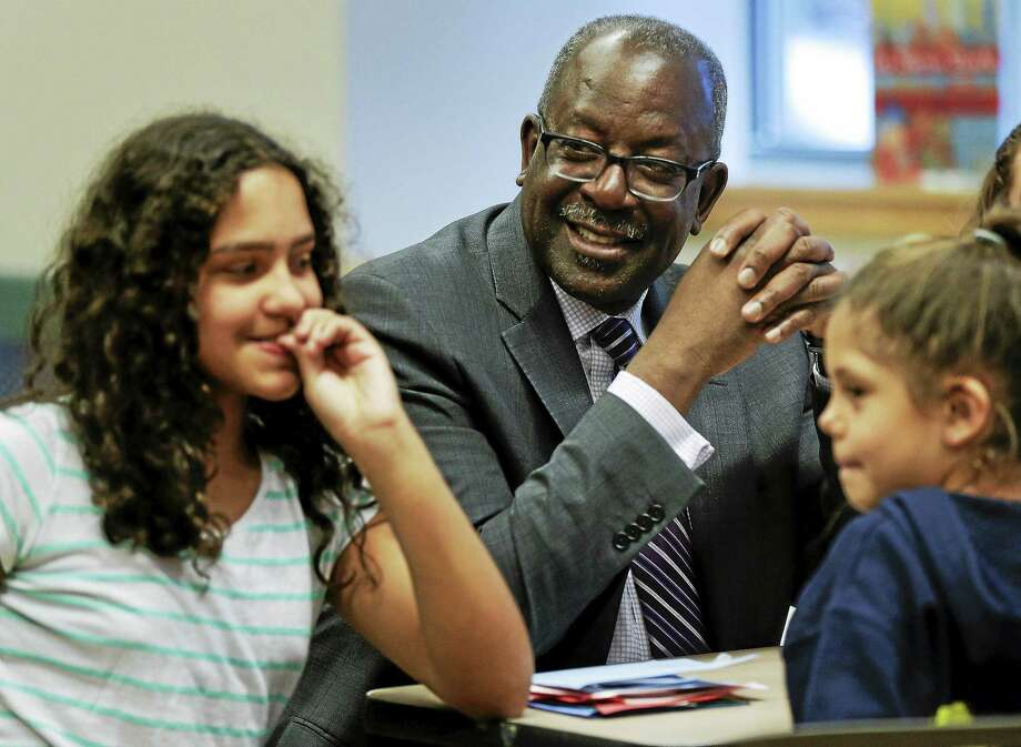 Kevin Washington, center, president and CEO of the YMCA of the USA, participates in a math game being played by young teens at the McBurney YMCA during an open after-school program called The Zone, Wednesday, April 22, 2015, in New York. Washington was installed as president and CEO in February and oversees 900 locally run associations which operate a total of 2,700 branches serving about 9 million youth and 13 million adults in communities ranging from affluent suburbs to hard-up inner-city districts. Photo: (AP Photo/Julie Jacobson) / AP