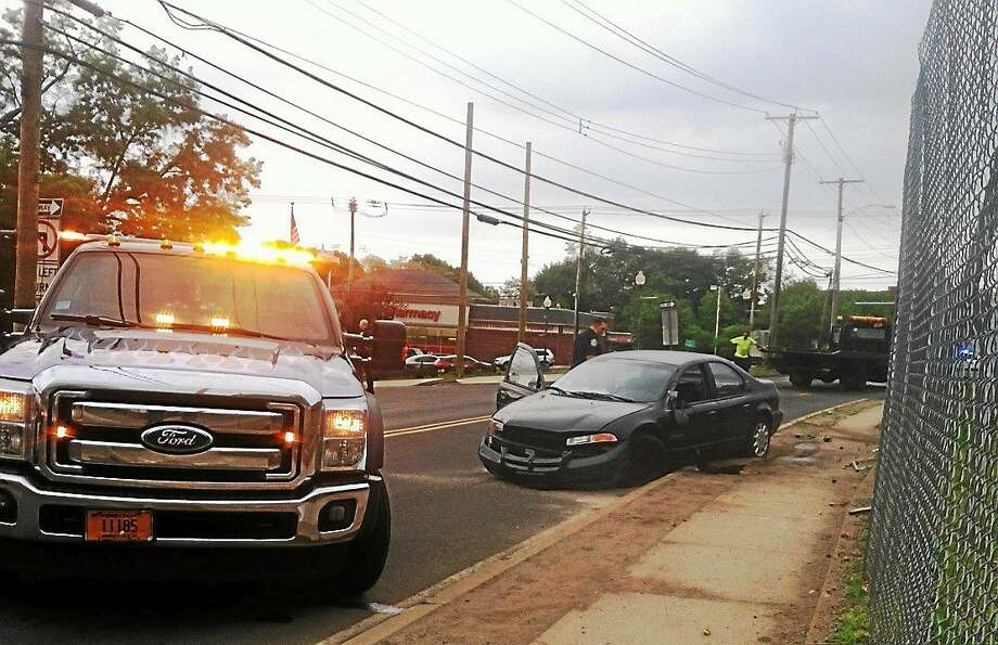 A man was arrested after he led police on a chase in a stolen car Sunday afternoon which ended when he lost control of the car near Boston Post Road and Cellini Place in West Haven. Photo: (Helen Bennett -- New Haven Register)