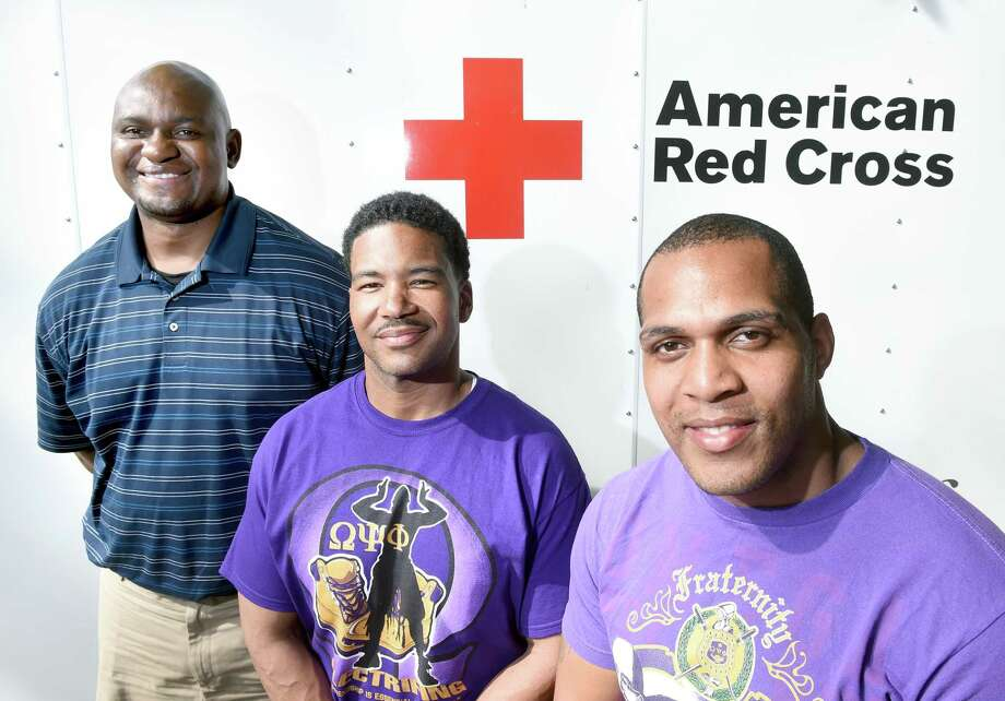 Left to right, American Red Cross account manager Max Yokono, Aurelious Woolfolk and Victor Jones of the Omega Psi Phi Fraternity of New Haven are photographed at the American Red Cross office in New Haven on 5/29/2015. Photo: (Arnold Gold-New Haven Register)