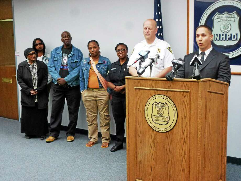 From left, Patricia Emory, aunt of slaying victim Albert Jenkins; Vandala Alton, a friend; Dennis Jenkins, uncle of the victim; Shantel Jenkins, the victim's sister; police Officer Jillian Knox; police Chief Dean Esserman; and Sgt. David Zannelli at a press conference Monday in New Haven. Photo: Ryan Flynn — New Haven Register