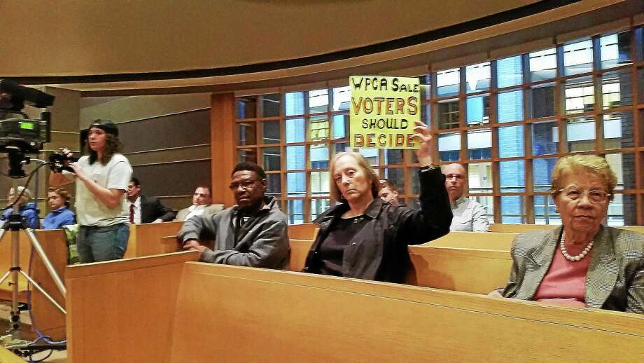 A group of residents opposing a proposal to allow the town of Stratford to join the Greater New Haven Water Pollution Control Authority attends a Board of Alders meeting Monday, including Stratford resident Terry Masters, who brought her own sign. Photo: Evan Lips - New Haven Register