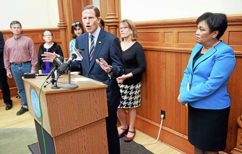 U.S. Senator Richard Blumenthal (center) speaks in favor of New Haven's effort to ban tobacco and e-cigarette use at city buildings, public parks and school grounds during a press conference at City Hall in New Haven on 5/1/2015. At right is New Haven Mayor Toni Harp. Photo: (Arnold Gold-New Haven Register)
