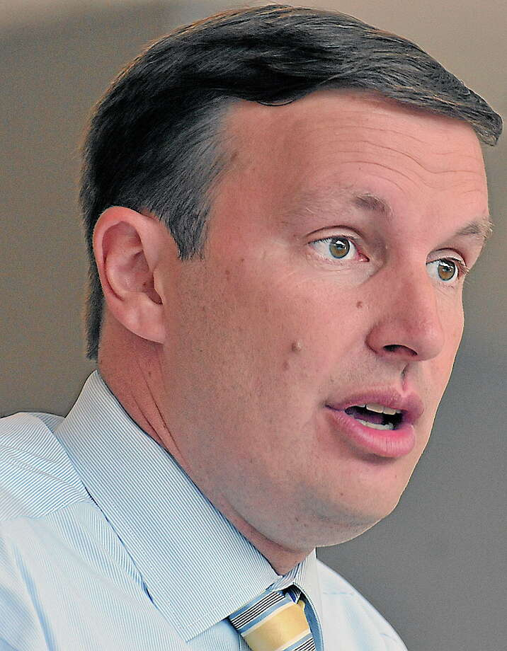Wallingford-- Senate candidate Chris Murphy speaks to employees and media at Proton OnSite, a Wallingford based company that develops Hydrogen Generation Systems. Murphy hit the campaign trail again after willing the democratic primary and quickly announced that he wants to debate Republican candidate Linda McMahon as soon as next week. Photo: Peter Casolino/New Haven Register 8/15/12