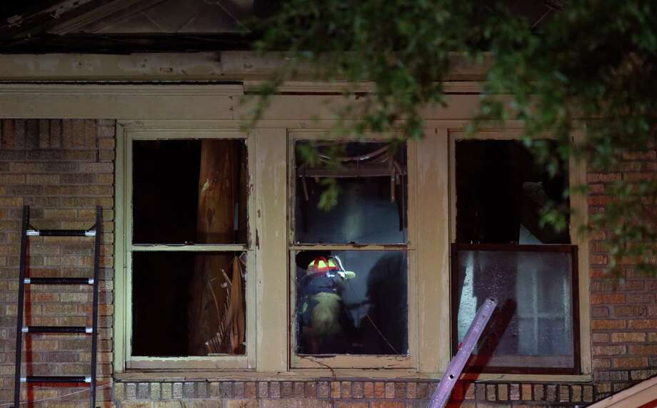 Houston firefighters battle a two-alarm fire at a home on the 2900 block of Cleburne Street Tuesday, July 25, 2017, in Houston. ( Godofredo A. Vasquez / Houston Chronicle ) Photo: Godofredo A. Vasquez / Houston Chronicle