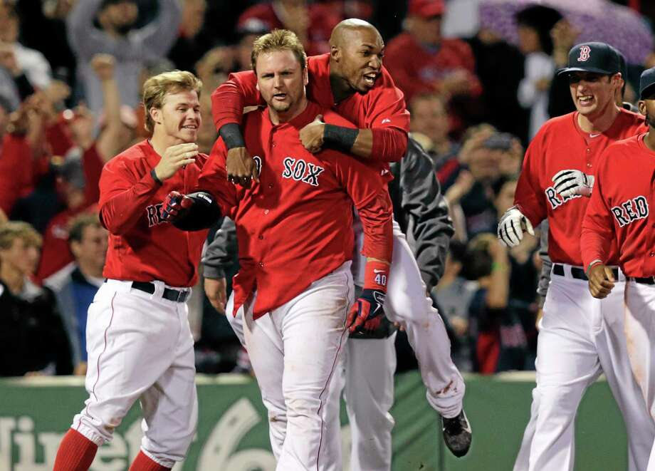 Boston Red Sox's A.J. Pierzynski is congratulated by teammates after his game-winning RBI triple in the bottom of the 10th inning off Tampa Bay Rays relief pitcher Juan Carlos Oviedo Friday. Photo: Charles Krupa — The Associated Press   / AP