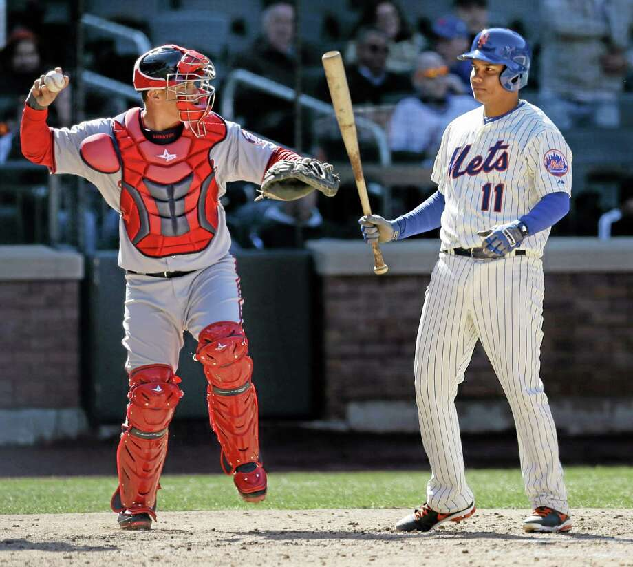 The Mets' Ruben Tejada, right, reacts after striking out while Washington Nationals catcher Wilson Ramos throws the ball in  the seventh inning of Monday's Opening Day loss at Citi Field in New York, The Nationals defeated the Mets in 10 innings 9-7. Photo: Seth Wenig — The Associated Press   / AP