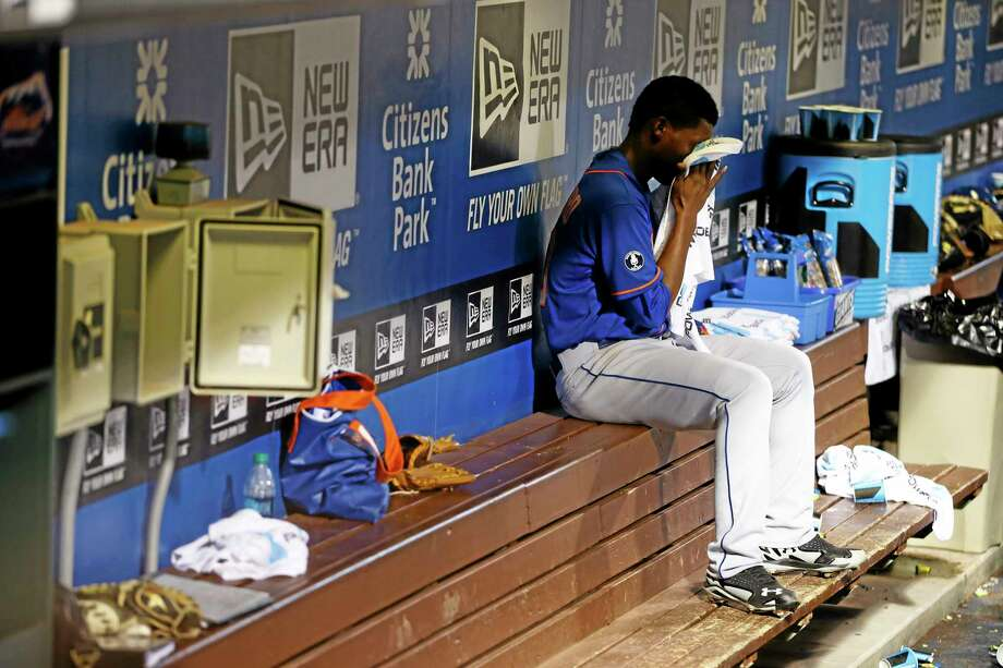 New York Mets starting pitcher Rafael Montero wipes his face on the bench after being pulled in the fourth inning against the Philadelphia Phillies. Photo: Matt Slocum — The Associated Press   / AP