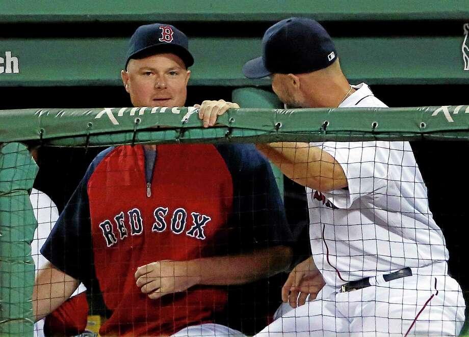 The Boston Red Sox traded pitcher Jon Lester, left, on Thursday. Photo: Elise Amendola — The Associated Press   / AP