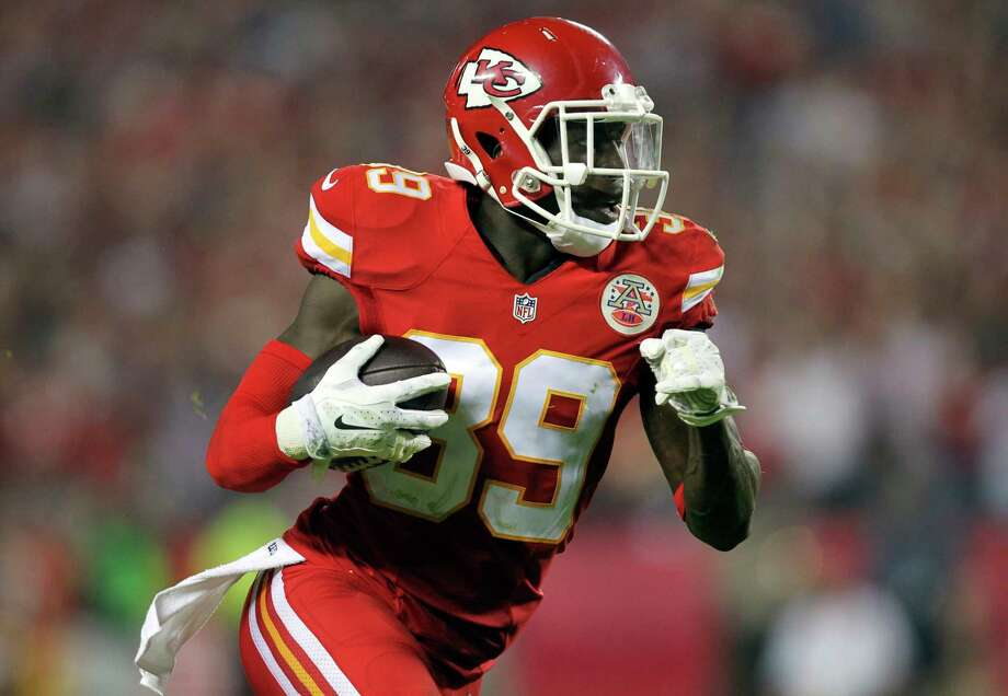 Chiefs free safety Husain Abdullah intercepts a pass and runs it back 39 yards for a touchdown during the fourth quarter of Monday's 41-14 win over the New England Patriots in Kansas City, Mo. Photo: Ed Zurga — The Associated Press   / FR34145 AP