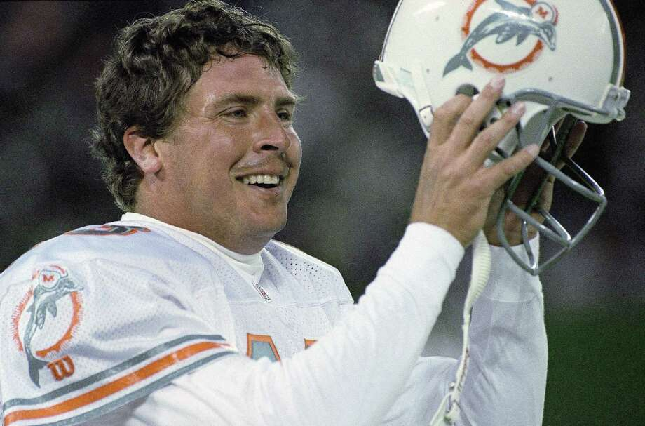In this 1994, file photo, Miami Dolphins quarterback Dan Marino removes his helmet after throwing the winning touchdown against the New York Jets. Photo: The Associated Press File Photo   / AP