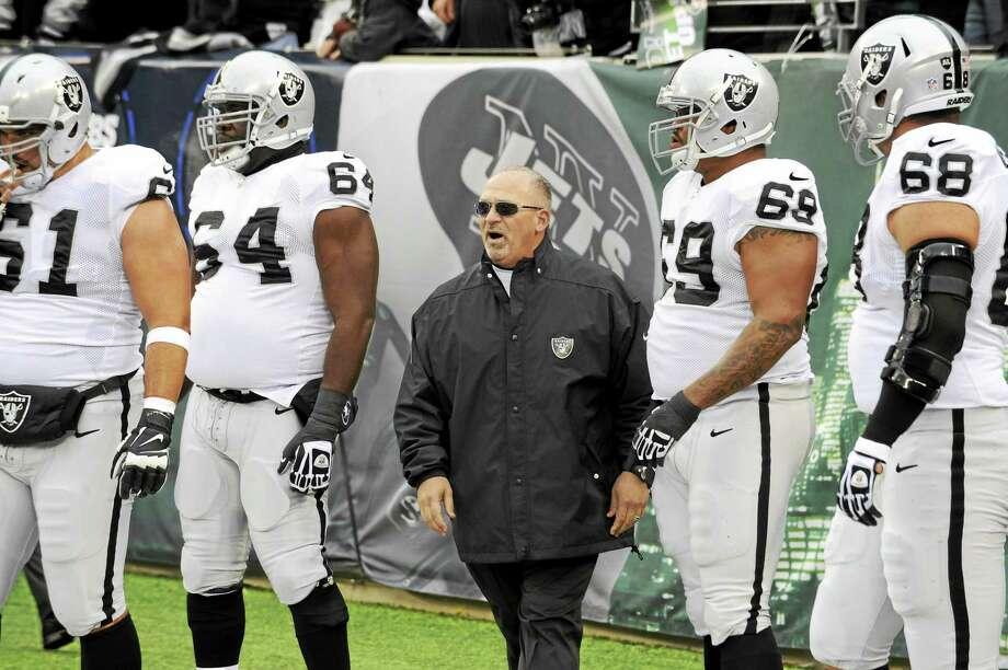 Tony Sparano, center, will become the interim head coach of the Oakland Raiders. Photo: Bill Kostroun — The Associated Press File Photo   / AP2013